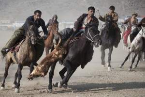 Afghans Play A Traditional Game Of Buzkashi