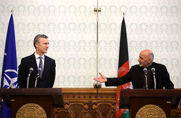 """Afghan President Ashraf Ghani, right, speaks as NATO Secretary General Jens Stoltenberg, listens during a joint press conference at the Presidential Palace in Kabul, Afghanistan, Tuesday, March 15, 2016. Afghanistan's president says the Islamic State group is """"on the run"""" in an eastern border province where in recent months they had taken over a number of remote districts. (AP Photo/Rahmat Gul)"""