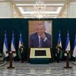 epa05521484 A handout picture dated and released on 03 September 2016 by the Kyrgyzstan Government Press Service shows Uzbek soldiers guard a huge picture of Uzbek President Islam Karimov in the hall for farewell ceremony in Samarkand, Uzbekistan, 03 September 2016. Uzbek government statement saying President Karimov has died 02 September. Islam Karimov reportedly suffered a brain haemorrhage on 27 August and has been in intensive care since. He was the President of Uzbekistan during 27 years he will funeral in his native town of Samarkand.  EPA/KYRGYZSTAN GOVERMENT PRESS SERVICE POOL  HANDOUT EDITORIAL USE ONLY/NO SALES