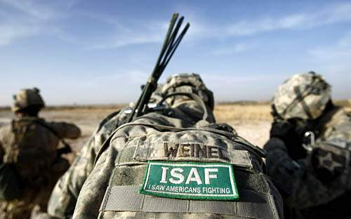 A different ISAF patch is attached to a backpack of a U.S. soldier of the 1st Battalion, 17th Infantry Regiment, 5th Brigade, 2nd Infantry Division, in the Badula Qulp area, west of Lashkar Gah in Helmand province, southern Afghanistan, Wednesday, Feb. 17, 2010. (AP Photo/Pier Paolo Cito)
